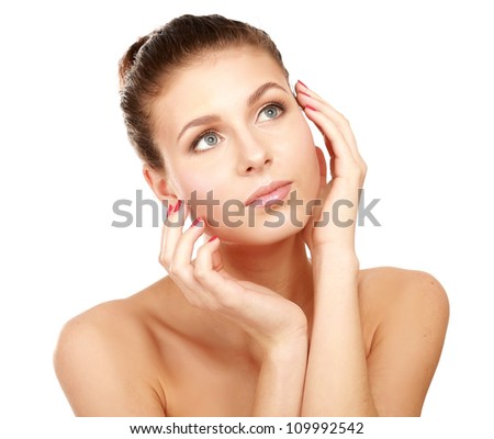 Young woman touching her face isolated on whire background
