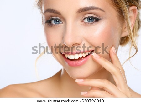 Stock Photo Young woman touching her face isolated on white background