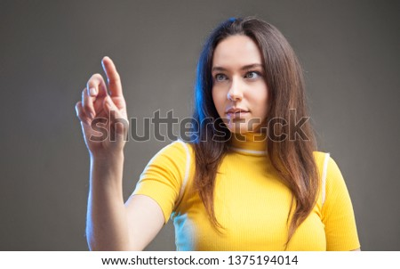 Young woman touching the empty screen #1375194014