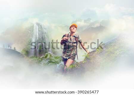 Young woman tourist with a backpack walking in the rain forest on background mountains. Concept eco tourism, hiking in the mountains.\ Concept eco tourism, hiking in the mountains.