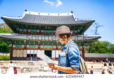 young woman tourist with map in ...
