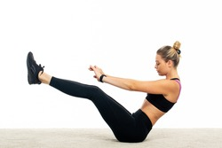 Young woman train abdominal muscles