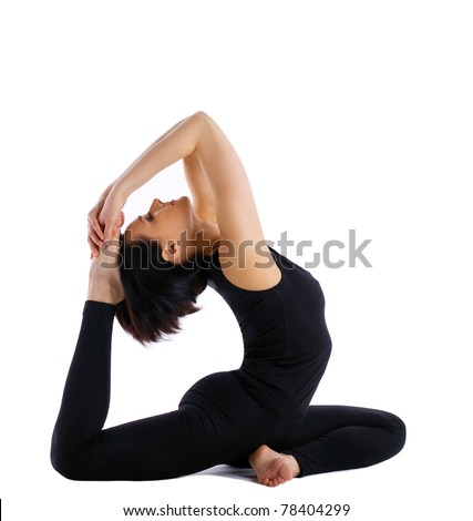 young woman training in yoga asana - pigeon pose isolated