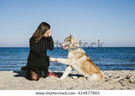 young woman training siberian...