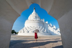 Young woman traveler at Hsinbyume Pagoda (white pagoda) the famous destination in Myanmar