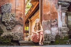 Young woman traveler in Ubud palace, Bali - Inside the Ubud palace, Bali, Indonesia