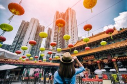 Young woman traveler is visiting at Wong Tai Sin temple in Hong Kong