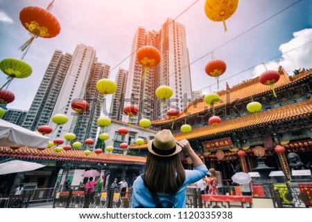 Young woman traveler is visiting at Wong Tai Sin temple in Hong Kong