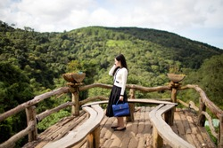 Young woman traveling at Hoa Son Dien Trang eco-tourism, a popular tourist destination in Da Lat, Lam Dong Province, Vietnam