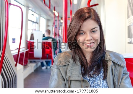 Young woman traveling by public transport