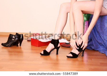 Young woman trying on new shoes in a store.