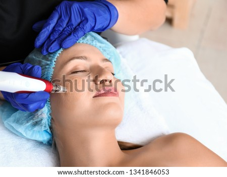 Young woman undergoing procedure of bb glow treatment in beauty salon #1341846053