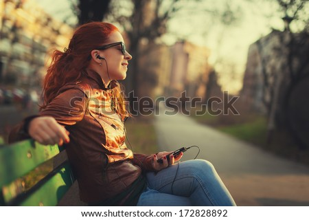 Young woman using a smart phone outdoors ストックフォト ©