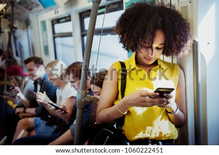 Young woman using a smartphone in the subway