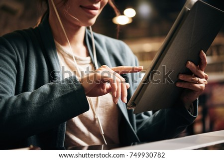 Young woman using application on tablet computer - Shutterstock ID 749930782
