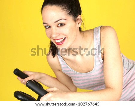 Young Woman Using Exercise Bike