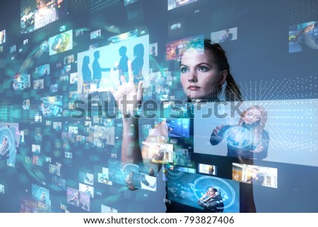 Young woman using futuristic interface. IoT(Internet of Things). ICT(Information Communication Network). Social media. Stock photo ©