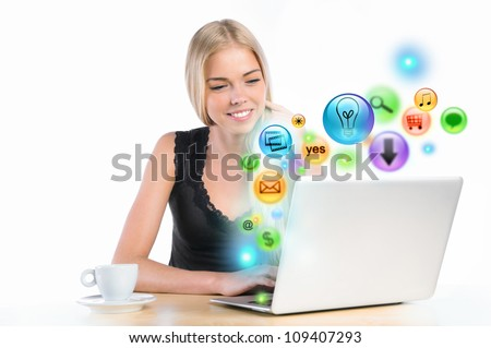 Young woman using her laptop for multimedia and site surfing. Different icons appearing from the screen