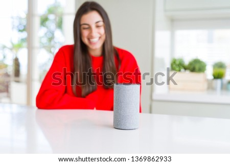 Young woman using home intelligent device, interactive voice assistant system #1369862933