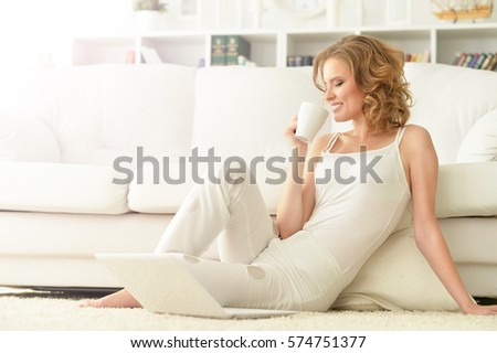 young woman using  laptop #574751377