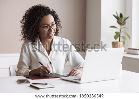Young woman using laptop computer at home. Student girl working in her room. Work or study from home, freelance, business, creative occupation, distance education, e-learning, lifestyle concept