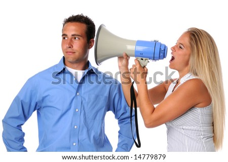Young woman using megaphone to communicate to uninterested man