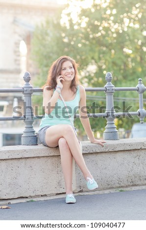 young  woman using mobile phone outdoor
