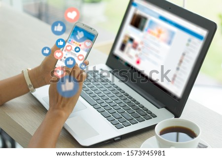Photo of  Young woman using smart phone,Social media concept.