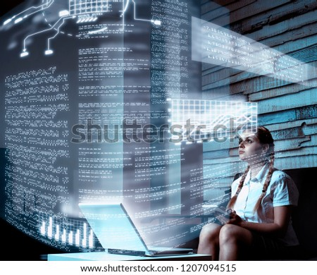 Young woman using tablet and infograph screen at home.Futuristic user interface. #1207094515
