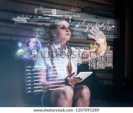 Young woman using tablet and infograph screen at home.Futuristic user interface. #1207095289