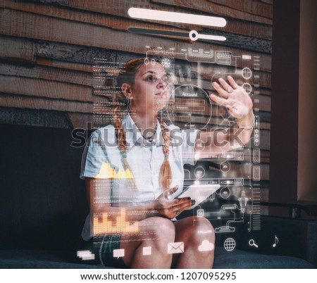 Young woman using tablet and infograph screen at home.Futuristic user interface. #1207095295