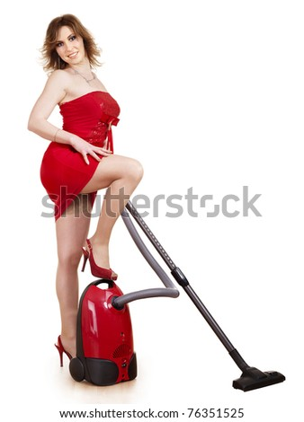 Young woman using vacuum cleaner. Isolated.