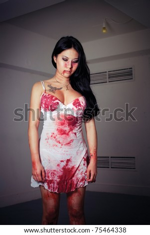 Young woman victim cover with blood.