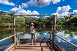 Young woman visiting a beautiful landscape in Bonito city, Brazil