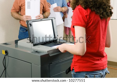 Young woman votes on florida's newest optical scanning machine.