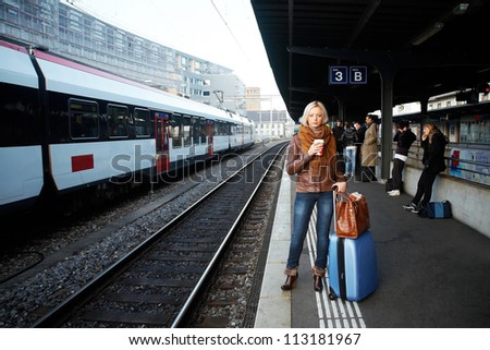 Young woman waiting a train on the station