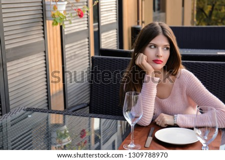 Young woman waiting for her boyfriend in cafe #1309788970