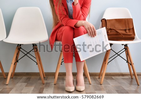 Young woman waiting for interview indoors Foto stock ©