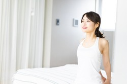 Young woman waking up refreshed