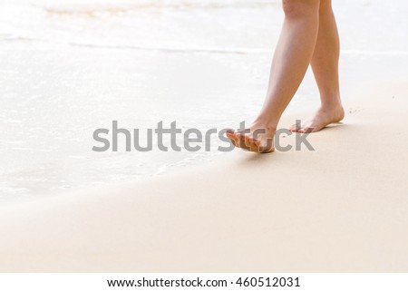 Young woman walking along the beach #460512031