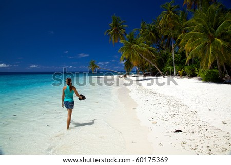 Young Woman Walking Along The Beach!