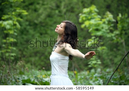 Young woman walking in a forest, freedom