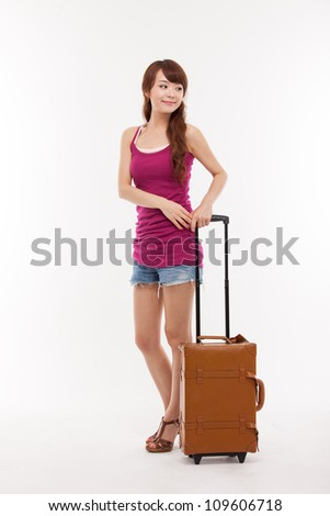 Young woman walking with luggage isolated over white