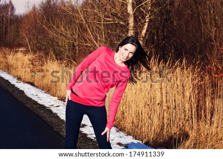 Young woman warms up before the jogging