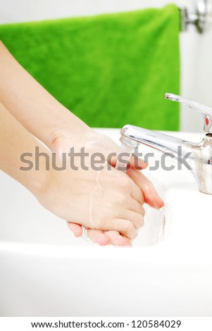 Young woman wash her hands