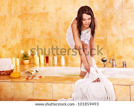 Young woman washing in bath their feet.