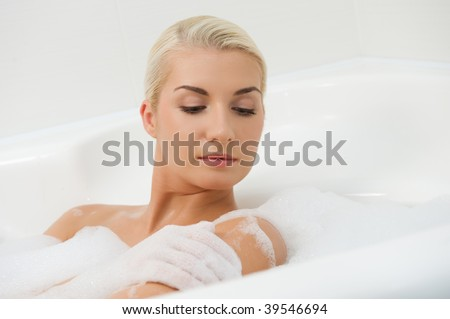 Young woman washing in bathroom