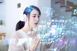 Young woman watching a futuristic display. Virtual reality concept.