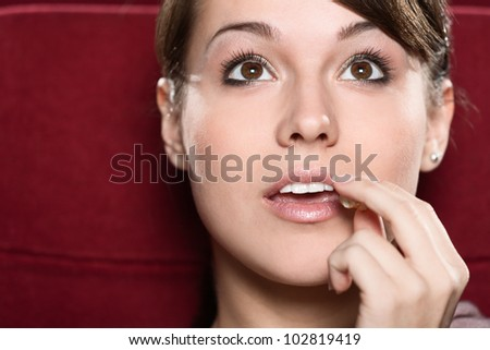 Young woman watching a movie at the cinema