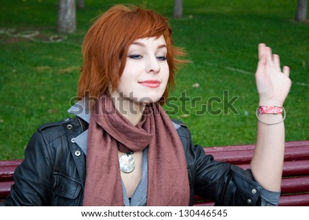 Young woman waves her hand